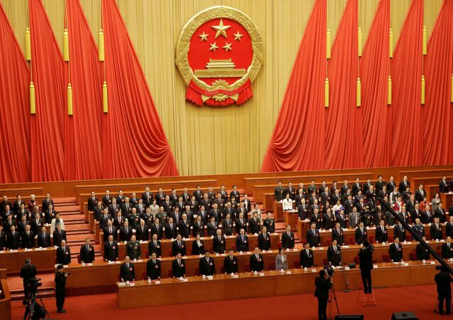File picture of officials singing the national anthem at the closing session last year of the National People's Congress (NPC) at the Great Hall of the People in Beijing, China March 15, 2019.