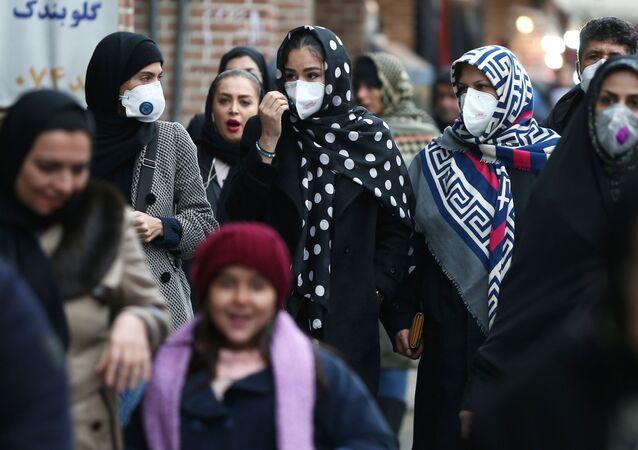Iranian women wearing protective masks to prevent contracting a coronavirus walk at Grand Bazaar in Tehran, Iran February 20, 2020.
