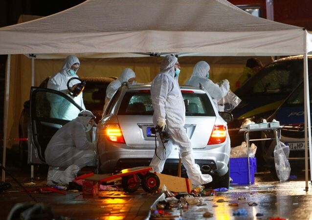 Police forensic officers work at the scene after a car ploughed into a carnival parade injuring several people in Volkmarsen, Germany February 24, 2020.