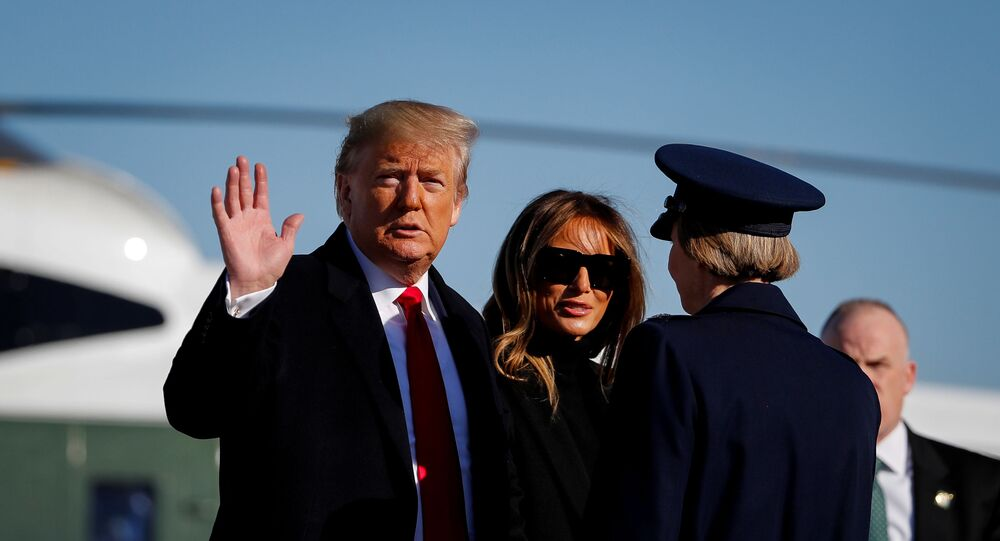 U.S. President Donald Trump waves as he and first lady Melania Trump board Air Force One to depart Washington for travel to India at Joint Base Andrews, Maryland, U.S., February 23, 2020.