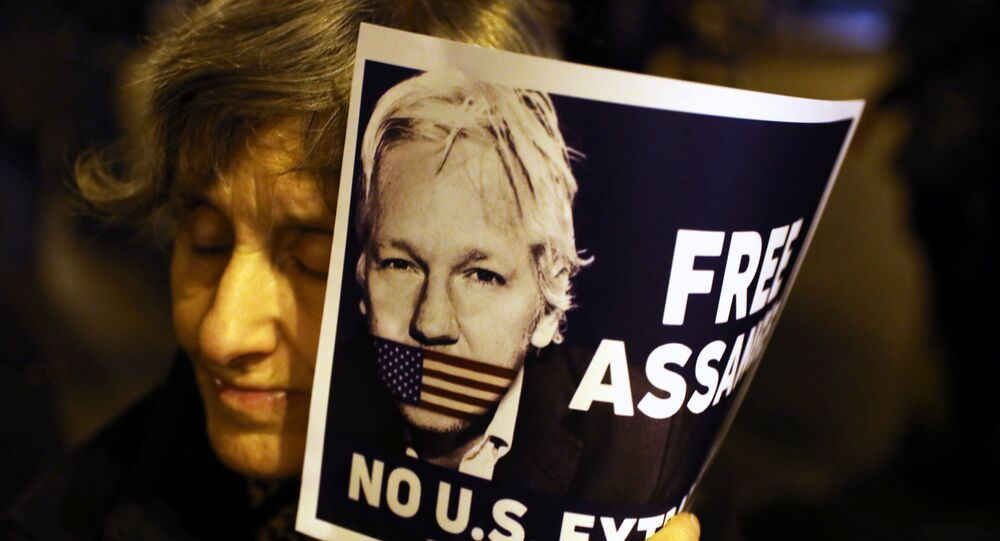 A demonstrator holds a placard in support of WikiLeaks founder Julian Assange during a protest against his extradition to the United States, in Barcelona, Spain February 24, 2020.