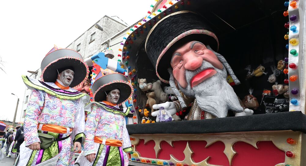 A float with an effegy of an ultra-Orthodox Jew is seen during a carnival parade in Aalst, Belgium