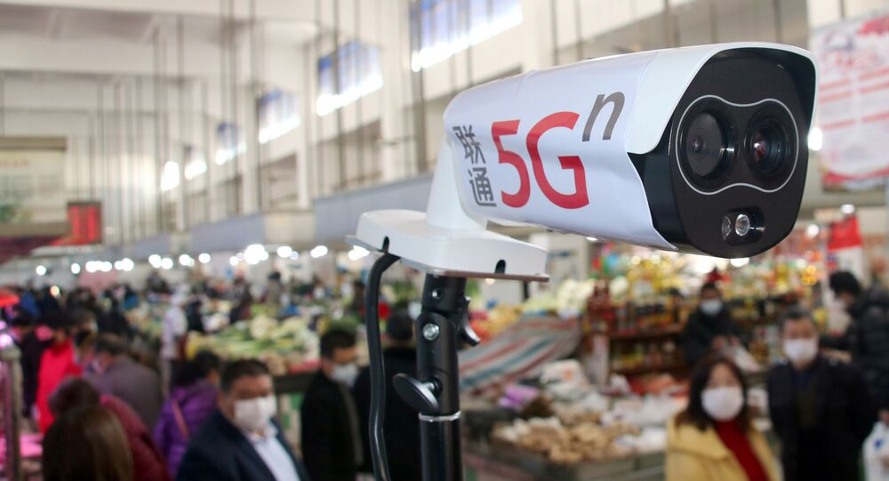 A 5G-powered camera to detect body temperature is seen at an agricultural market, as the country is hit by an outbreak of the novel coronavirus, in Suzhou, Jiangsu province, China February 20, 2020