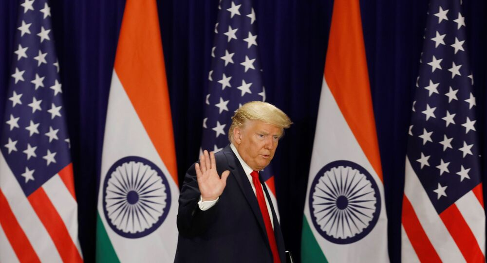 U.S. President Donald Trump waves as he leaves after a news conference in New Delhi, India, February 25, 2020