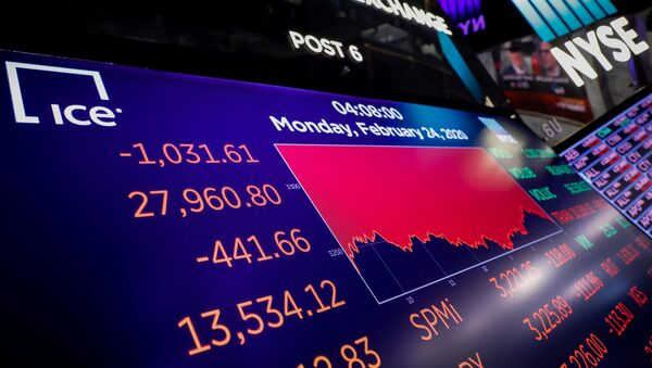 A screen displays the Dow Jones Industrial Average after the closing bell on the floor at the New York Stock Exchange (NYSE) in New York, U.S., February 24, 2020. REUTERS/Brendan McDermid - Sputnik International