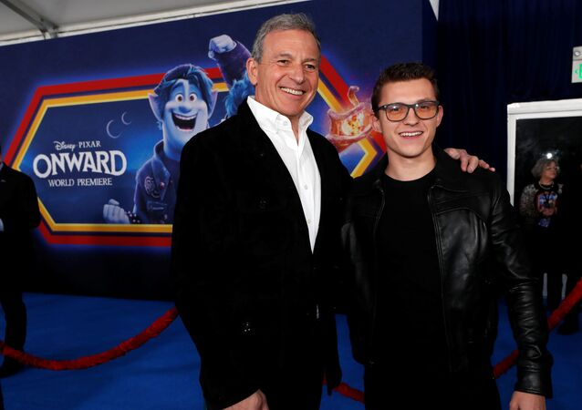 Cast member Tom Holland and Bob Iger, CEO of the Walt Disney Company, pose at the premiere for the film Onward in Los Angeles, California, U.S. February 18, 2020.