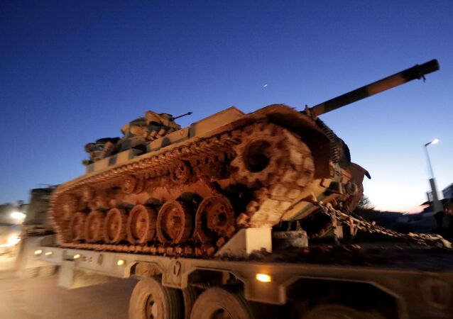 Turkish military vehicles enter the Bab al-Hawa crossing at the Syrian-Turkish border, in Idlib governorate, Syria, February 9, 2020