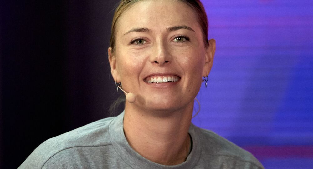 Maria Sharapova, of Russia, speaks with the media during the news conference at the St. Petersburg Ladies Trophy, in St. Petersburg, Russia. Sharapova withdrew from tournament with shoulder injury