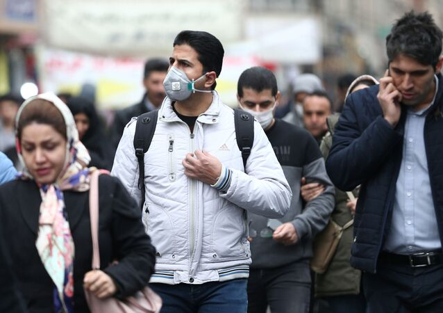 Iranian men wearing protective masks to prevent contracting a coronavirus walk at Grand Bazaar in Tehran, Iran February 20, 2020