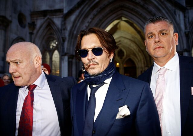 Actor Johnny Depp leaves the High Court in London, Britain