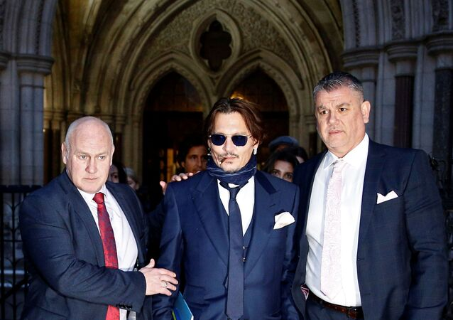 Actor Johnny Depp leaves the High Court in London, Britain, February 26