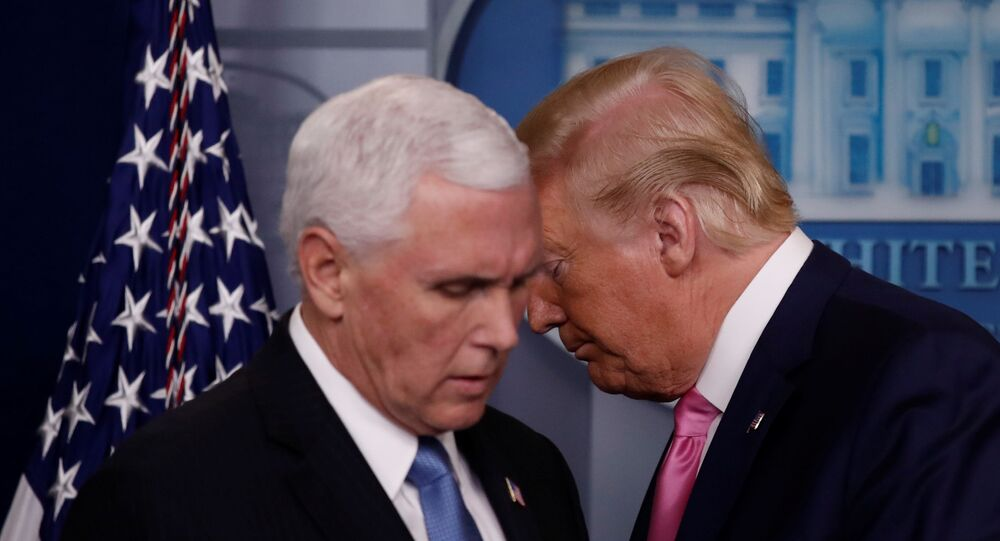 U.S. President Donald Trump walks past Vice President Mike Pence during a news conference at the White House in Washington, U.S., February 26, 2020.  REUTERS/Carlos Barria
