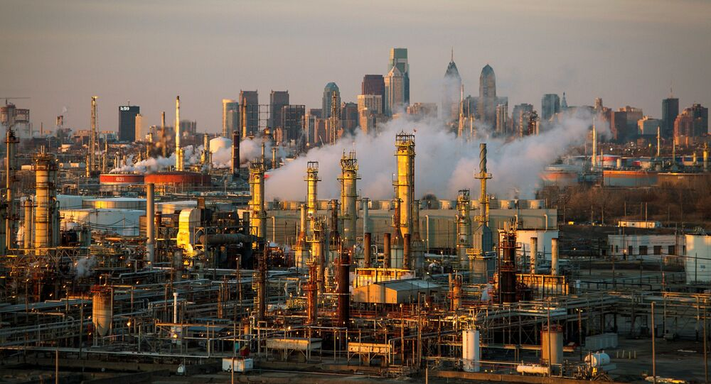The Philadelphia Energy Solutions oil refinery is seen at sunset in front of the Philadelphia skyline March 24, 2014