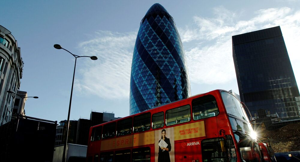 An Arriva bus passes the Swiss Re building in the City of London