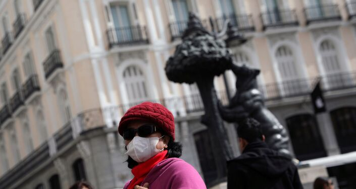 A tourist wears a protective mask outside Puerta del Sol square amid the novel coronavirus outbreak in Madrid, Spain, February 27, 2020