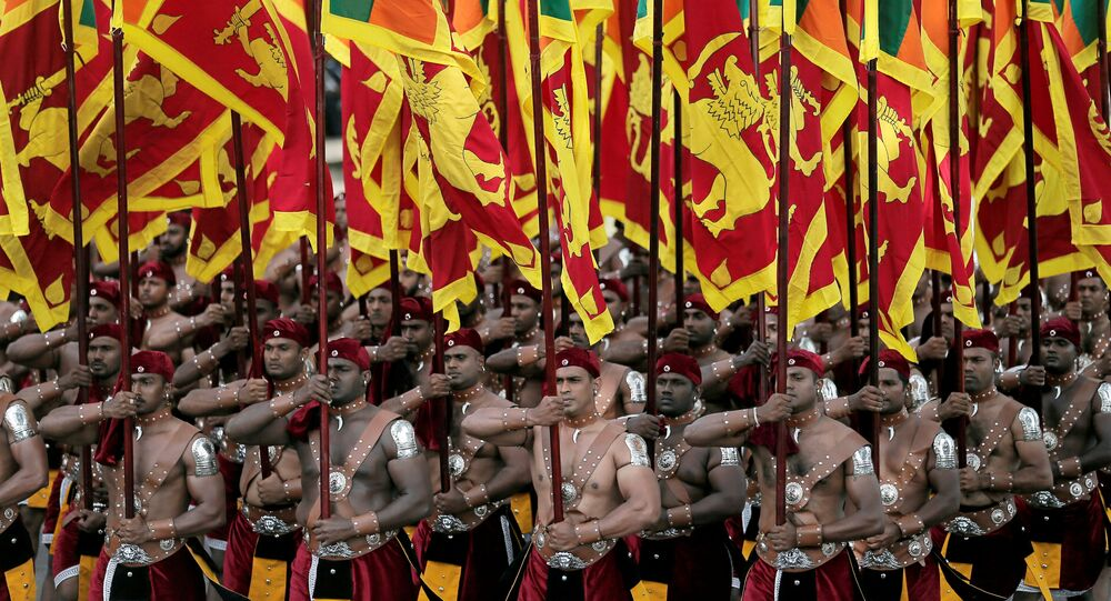 Sri Lanka's military march with national flags during the 72nd independence day ceremony, in Colombo, Sri Lanka February 4, 2020