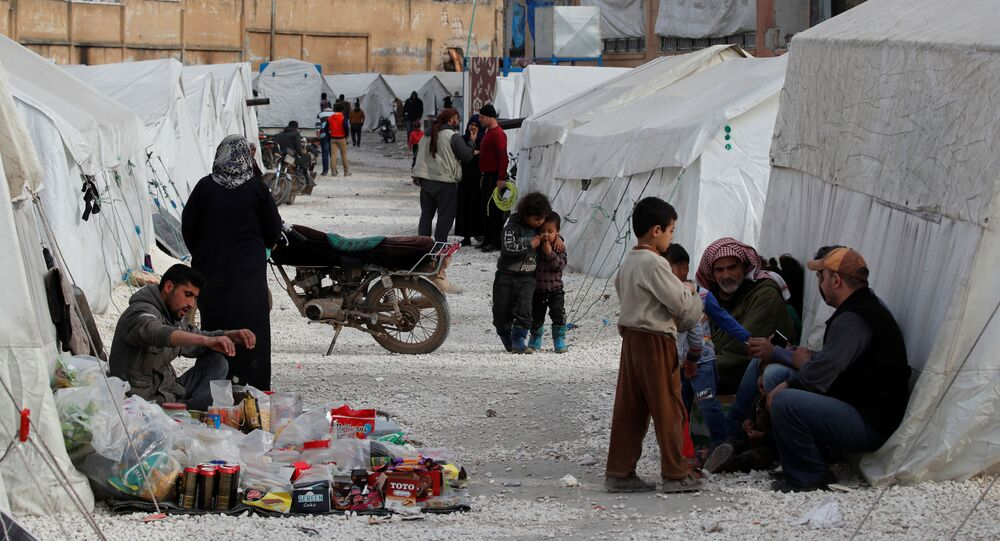 Internally displaced Syrians are seen in an IDP camp located in Idlib, Syria, 27 February 2020.