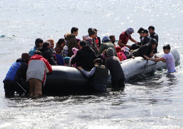 Migrants board a dinghy bound for the Greek island of Lesbos, off the coast of the Turkish coastal town of Ayvacik in Canakkale province, Turkey, 28 February  2020.
