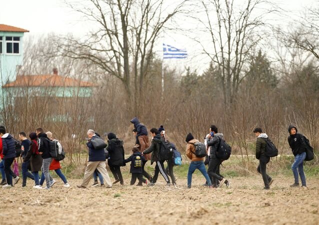 Migrants walk to the Turkey's Pazarkule border crossing with Greece's Kastanies, in Pazarkule, Turkey, February 28, 2020