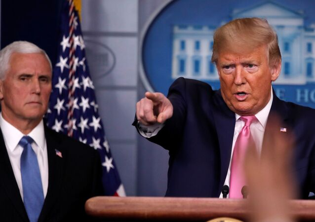 U.S. President Donald Trump answers a question next to Vice President Mike Pence during a news conference on the coronavirus outbreak at the White House in Washington, U.S., February 26, 2020.