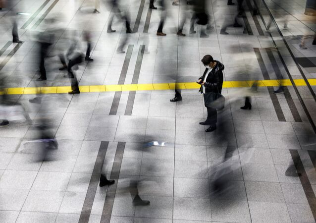 A man wearing a protective face mask, following an outbreak of the coronavirus, stands at the Shinagawa station in Tokyo, Japan, February 28, 2020. REUTERS/Athit Perawongmetha