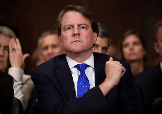 FILE PHOTO: White House Counsel Don McGahn listens to Supreme Court nominee Brett Kavanaugh as he testifies before the US Senate Judiciary Committee on Capitol Hill in Washington, DC, U.S., September 27, 2018.