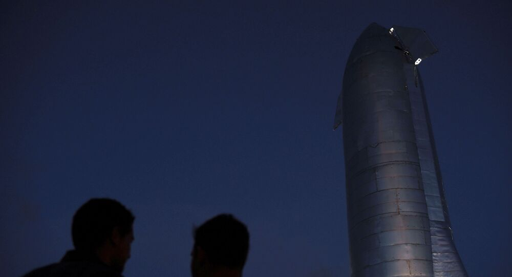 A crowd gathers before SpaceX's Elon Musk gives an update on the company's Mars rocket Starship SN1 in Boca Chica, Texas, 28 September 2019
