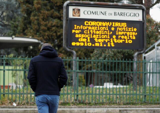 Schoolteacher Alessio Villarosa walks on a street in the small town of Bareggio near Milan, Italy February 29, 2020.