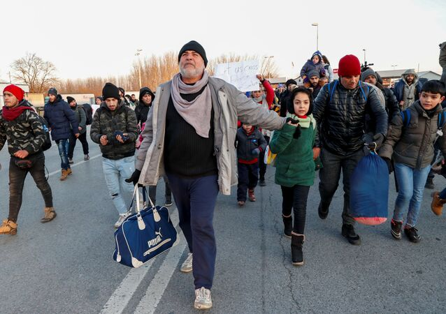 Migrants walk to the Serbian-Hungarian border as they protest to demand a passage to the European Union, near Kelebija, Serbia, February 6, 2020.