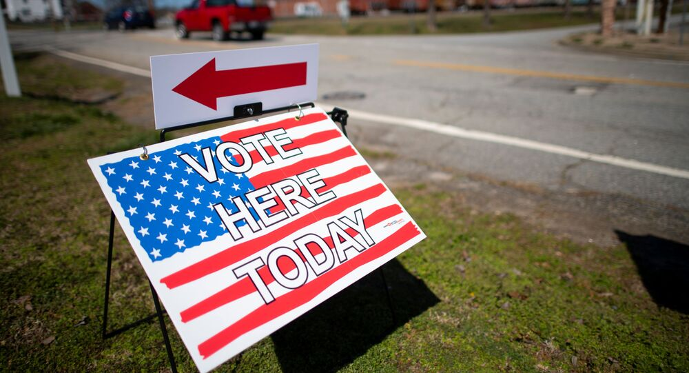 A placard stating VOTE HERE TODAY is seen outside the Cowpens Depot Center polling location on the day of the South Carolina Presidential Primary in Cowpens, South Carolina, 29 February 2020. REUTERS/Mark Makela