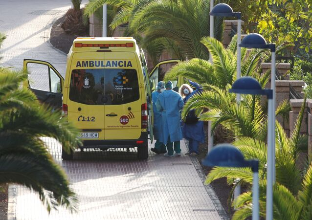 A tourist affected by coronavirus is transferred to a hospital from the hotel H10 Costa Adeje Palace, which is on lockdown after novel coronavirus has been confirmed in Adeje, on the Spanish island of Tenerife, Spain, February 29, 2020. REUTERS/Borja Suarez