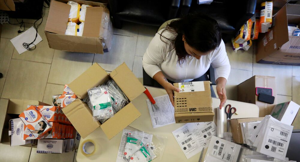 An employee packs medical masks, that are part of personal protection and survival equipment kits ordered by customers preparing against novel coronavirus, at a centre of an express delivery company in Porto Alegre, Brazil February 28, 2020. REUTERS/Diego Vara