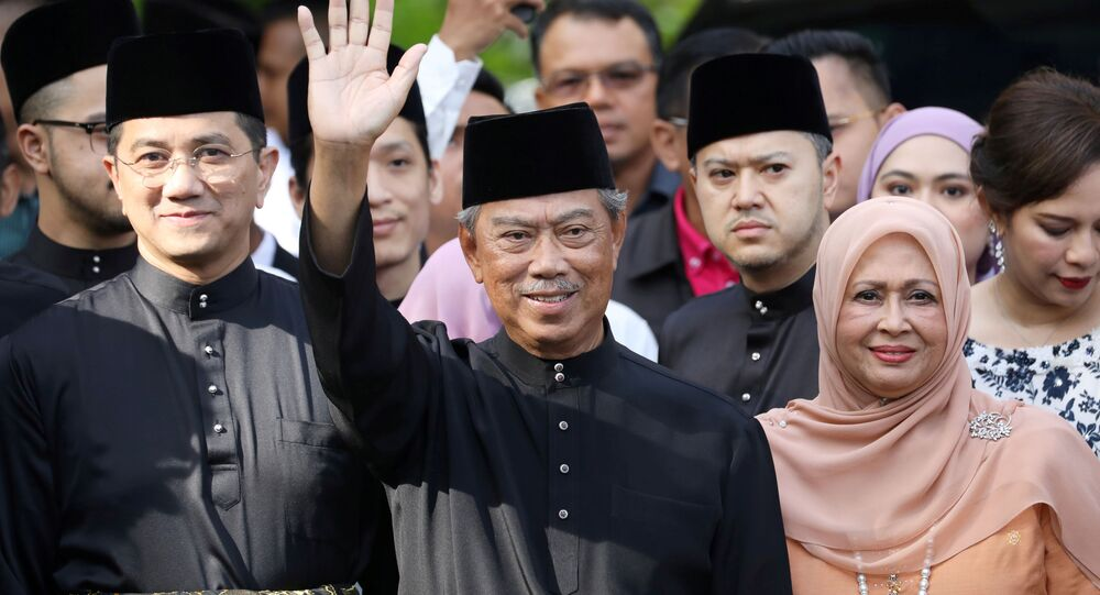 Malaysia's Prime Minister Designate and former interior minister Muhyiddin Yassin waves to reporters before his inauguration as the 8th prime minister, outside his residence in Kuala Lumpur, Malaysia, March 1, 2020. REUTERS/Lim Huey Teng     TPX IMAGES OF THE DAY