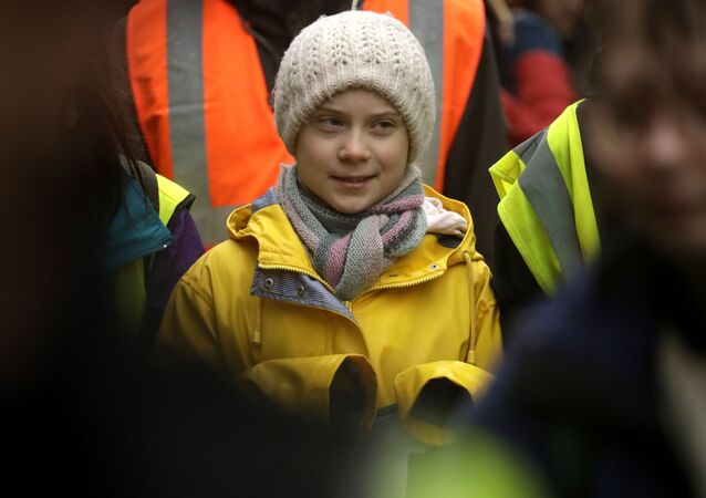Climate activist Greta Thunberg, from Sweden marches with other demonstrators as she participates in a school strike climate protest in Bristol, south west England, Friday, Feb. 28, 2020.