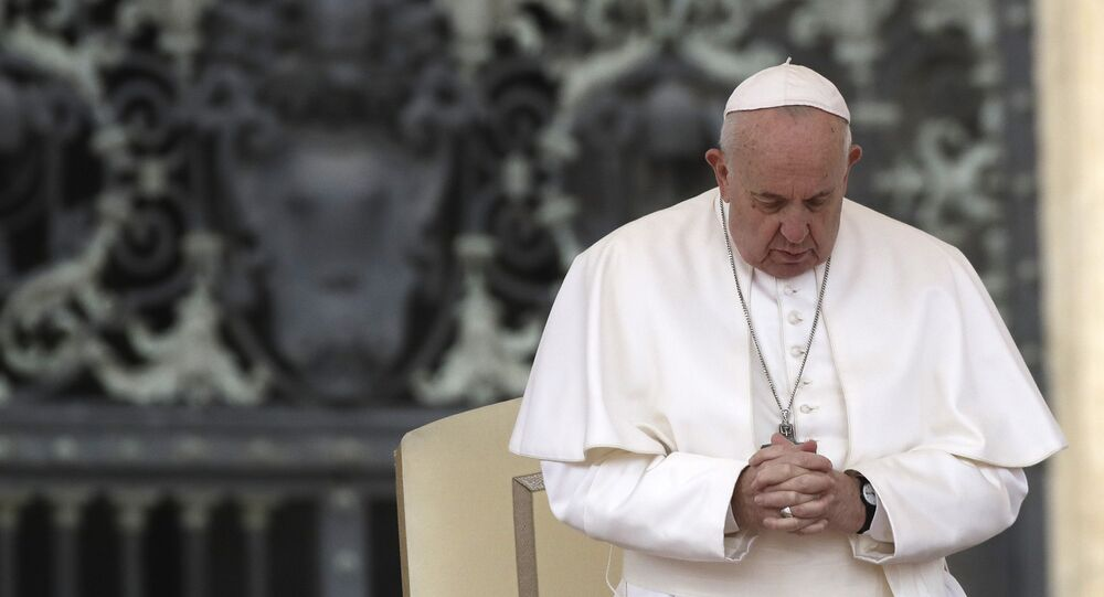 Pope Francis prays in St. Peter's Square at the Vatican during his weekly general audience, Wednesday, Feb. 26, 2020.