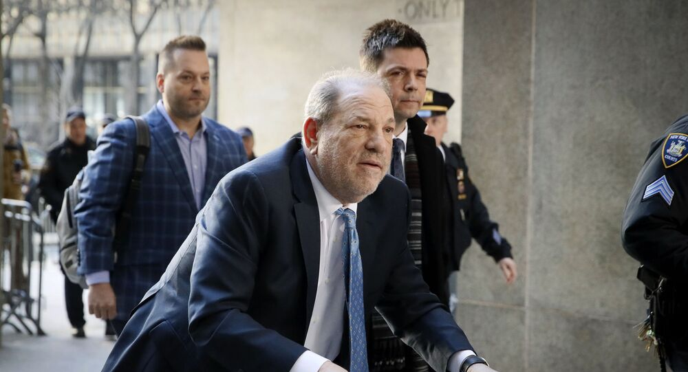 Harvey Weinstein arrives at a Manhattan courthouse as jury deliberations continue in his rape trial, 24 February 2020, in New York.