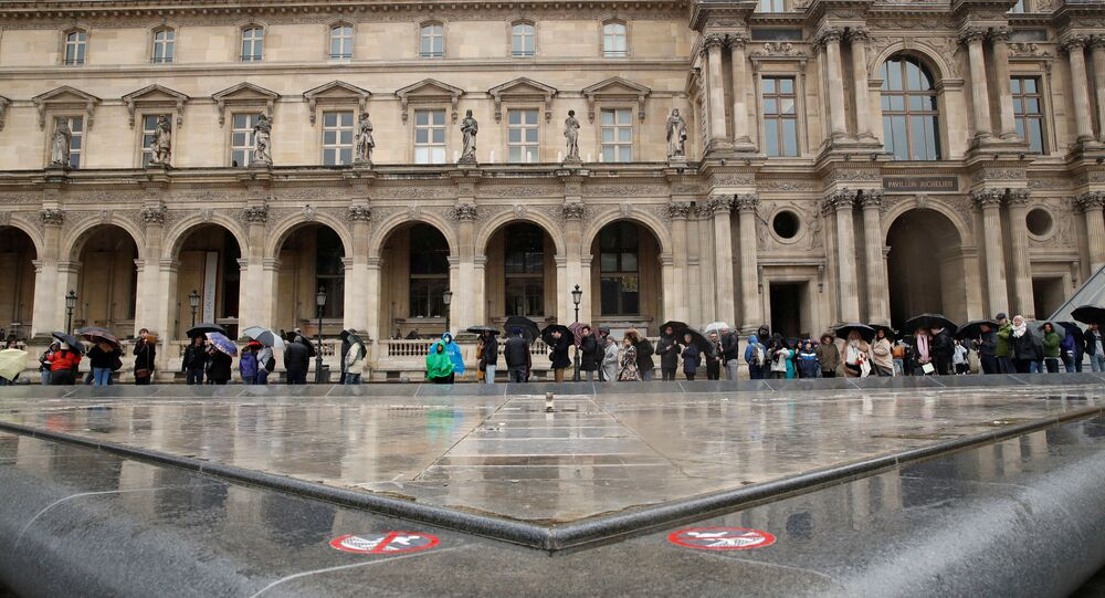 People line up at the Louvre Museum as the staff closed the museum during a staff meeting about the coronavirus outbreak, in Paris, France, March 1, 2020.