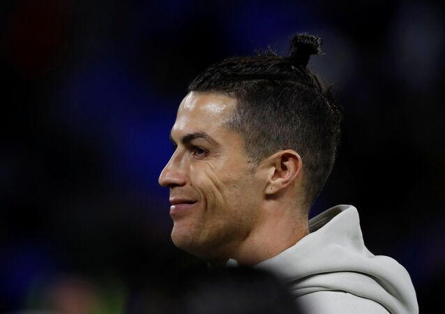 Soccer Football - Champions League - Round of 16 First Leg - Olympique Lyonnais v Juventus - Groupama Stadium, Lyon, France - 26 February 2020  Juventus' Cristiano Ronaldo during the warm up before the match