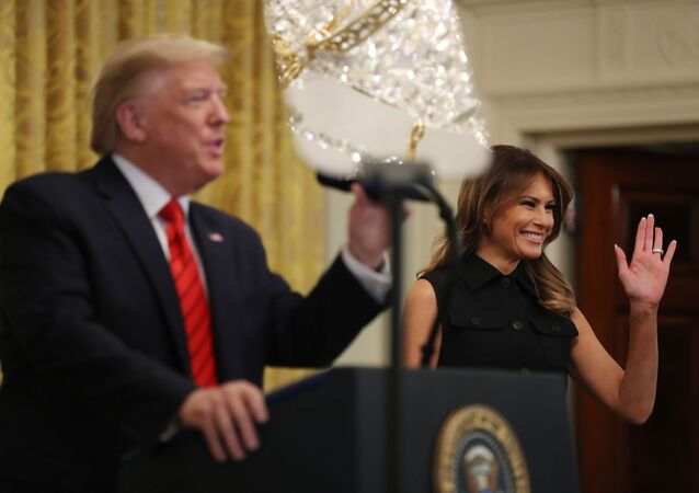 WASHINGTON, DC - FEBRUARY 27: U.S. President Donald Trump (L) and first lady Melania Trump take the stage during a Black History Month reception in the East Room of the White House February 27, 2020 in Washington, DC.