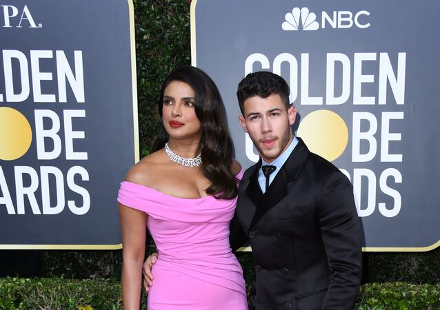 BEVERLY HILLS, CALIFORNIA - JANUARY 05: Priyanka Chopra Jonas (L) and Nick Jonas attend the 77th Annual Golden Globe Awards at The Beverly Hilton Hotel on January 05, 2020 in Beverly Hills, California.