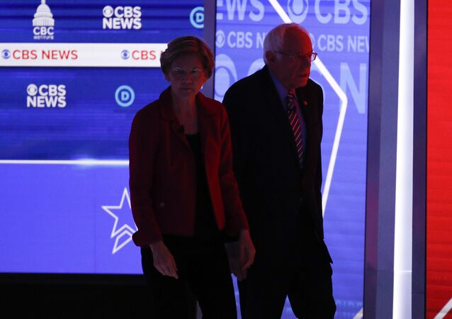 Democratic presidential candidates, Sen. Elizabeth Warren, D-Mass., left, and Sen. Bernie Sanders, I-Vt., right, walks off the stage during a commercial break as they participate in a Democratic presidential primary debate at the Gaillard Center, Tuesday, Feb. 25, 2020, in Charleston, S.C., co-hosted by CBS News and the Congressional Black Caucus Institute.