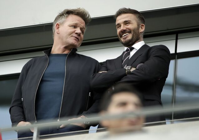 Celebrity chef Gordon Ramsay (left) shares some banter with David Beckham as they watch Inter Miami's first game, in Los Angeles