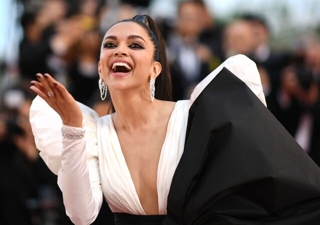 Danish-born Indian actress Deepika Padukone poses as she arrives for the screening of the film Rocketman at the 72nd edition of the Cannes Film Festival in Cannes, southern France, on May 16, 2019.