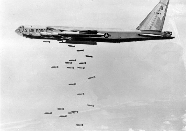 A U.S. Air Force B-52 delivers a bomb load of more than 38,000 pounds during the Vietnam War.