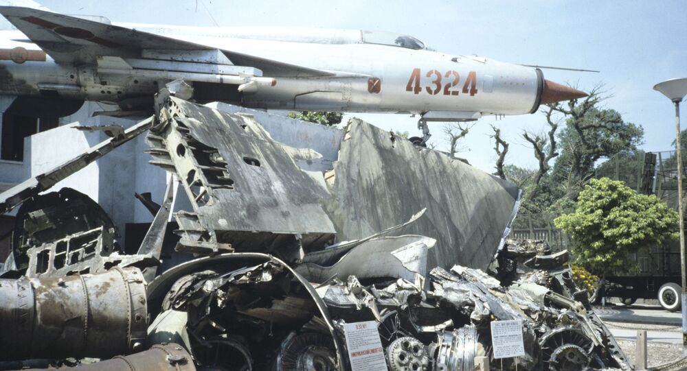 A MiG-21 on display alongside the remains of B-52 bombers at the Vietnam Military History Museum in central Hanoi.