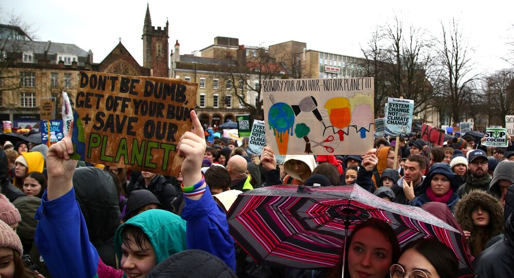 Young demonstrators hold placards as they attend a Youth Strike 4 Climate protest in Bristol, south west England on February 28, 2020.