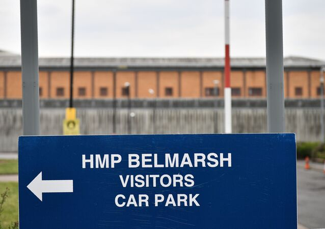 A sign directs people to the visitors car park at Belmarsh prison in south east London