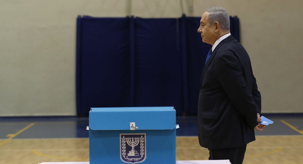Israeli Prime Minister Benjamin Netanyahu prepares to cast his ballot during the Israeli legislative elections at a polling station in Jerusalem, Monday, March 2, 2020. Israelis have begun voting in the country's unprecedented third election in less than a year.