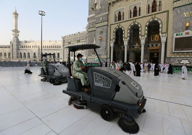 Labourers wearing masks clean the floor of the Grand Mosque in Saudi Arabia's holy city of Mecca on February 28, 2020.