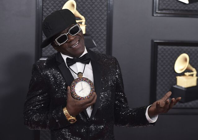 Flavor Flav arrives at the 62nd annual Grammy Awards at the Staples Center on Sunday, Jan. 26, 2020, in Los Angeles